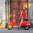 Foto Stock: Vintage image of young attractive girl and old scooter