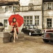 Vintage image of young attractive girl with two old cars — Stock Photo #14935763