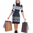 Young attractive girl in native scandinavian clothes makes shopping isolated on white — Stock Photo #14936063