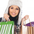 Young attractive girl in native scandinavian clothes makes shopping - Zdjęcie stockowe