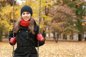 Young attractive girl in autumn park — Stock Photo