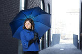 Fashion shoot of young attractive woman with umbrella — Stock Photo