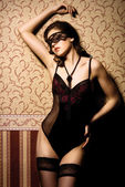 Fashion shoot of beautiful woman in luxury lingerie over vintage background — Stock Photo