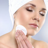 Young attractive woman in towel making the spa treatment — Stock Photo