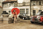 Vintage image of young attractive girl with two old cars — Foto Stock