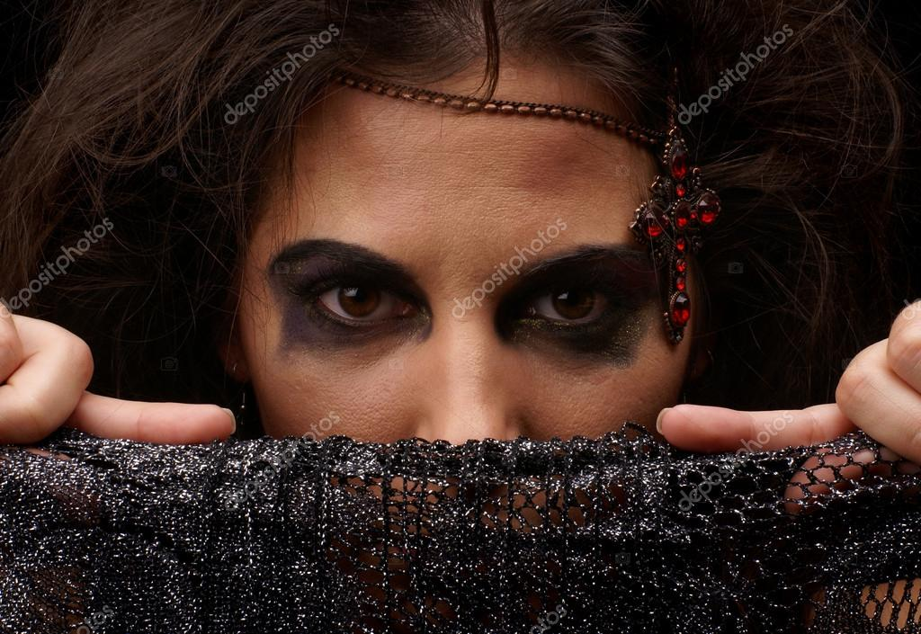 Portrait of witch over dark background                Stock Photo #14930067