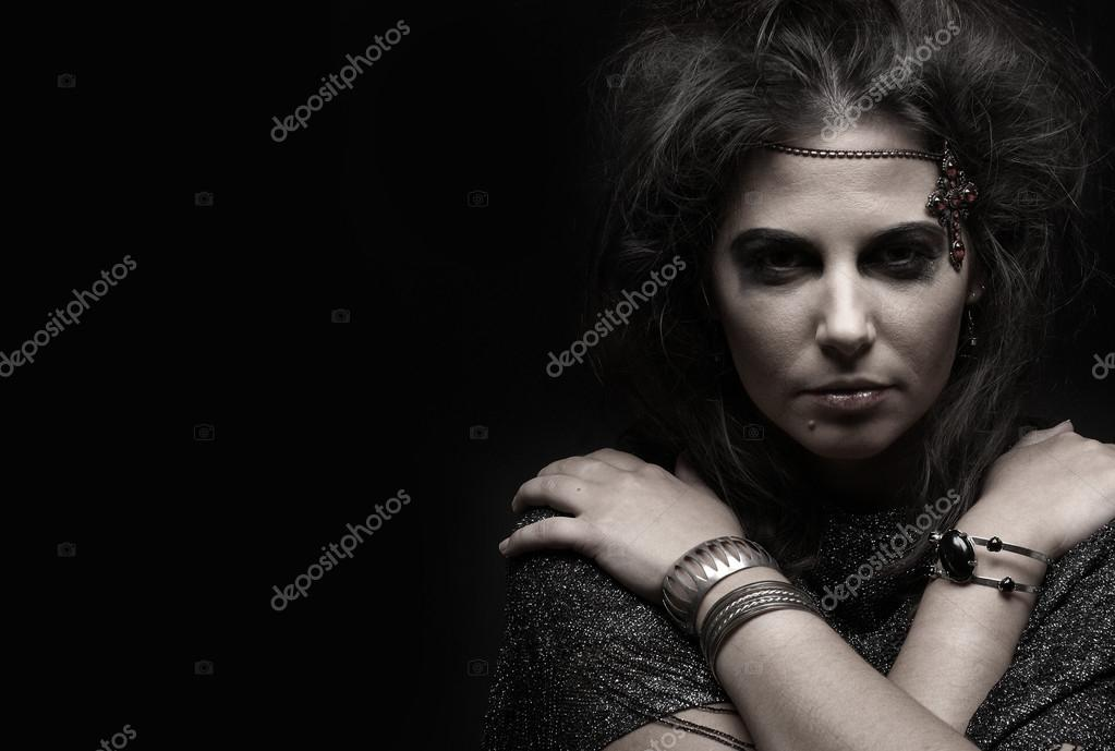 Portrait of witch over dark background               — Stockfoto #14930435