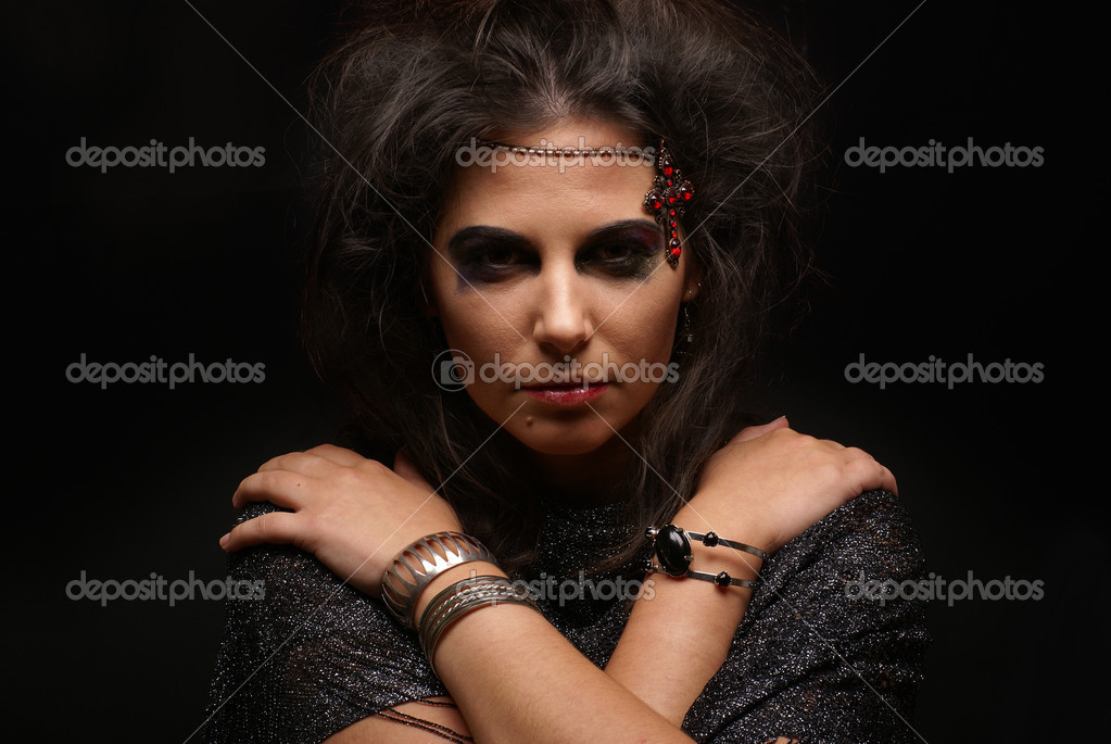 Portrait of witch over dark background               — Stock Photo #14930485