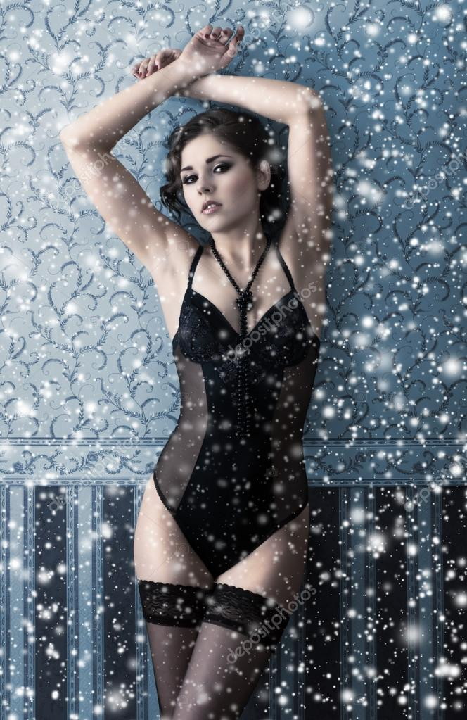 Fashion shoot of beautiful woman in luxury lingerie over Christmas background  Stock Photo #14934109