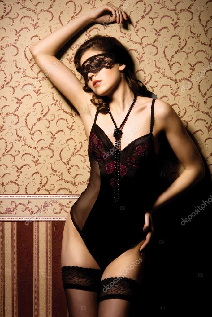 Fashion shoot of beautiful woman in luxury lingerie over vintage background — Stock Photo #14934421