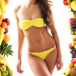 Dieting concept with a nice belly and some fruits — Stock Photo