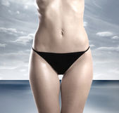 Belly of beautiful woman — Stock Photo