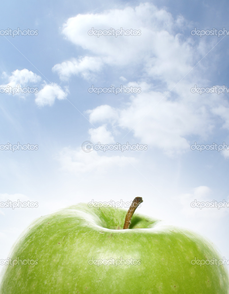 Green tasty sweet apple over sky background               — Stock Photo #14961735