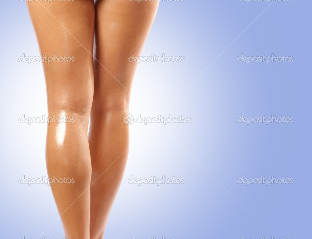 Back and ass of beautiful woman over blue background — Stock Photo #14962041