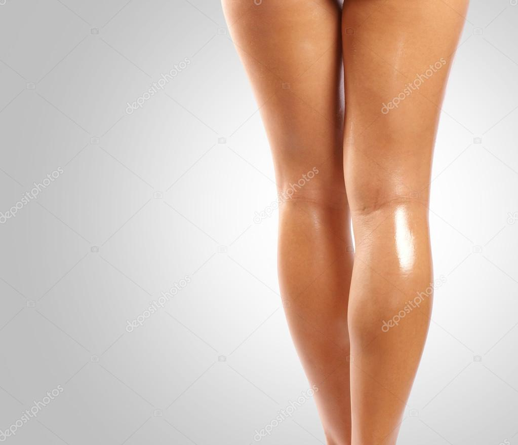 Back and ass of beautiful woman over grey background — Stock Photo #14962087
