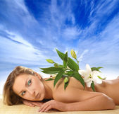 Attractive woman laying on the beach — Stock Photo