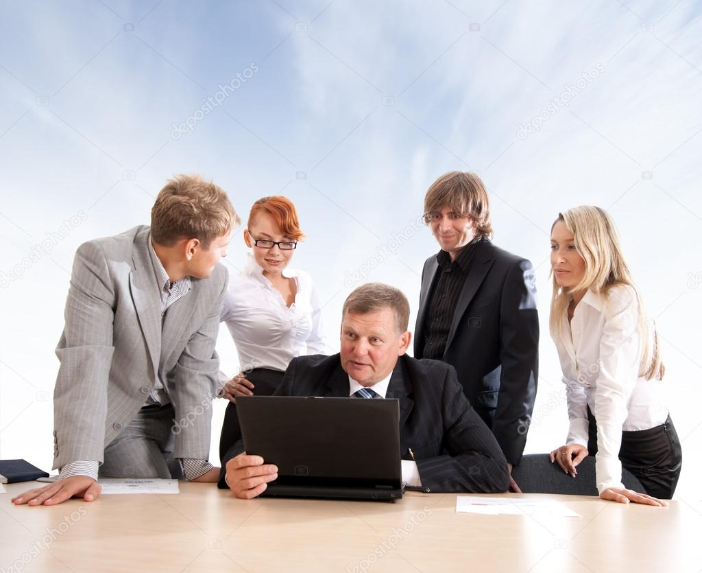 Business group of two young ladies, two young men and a mature boss at work over abstract sky background — Stock Photo #14978211