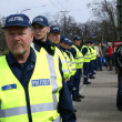 Stock Photo: Police officers near Bronze Soldier in Tallinn Estoni26.04.07