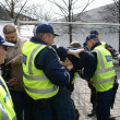 Stock Photo: Police officers arrest near Bronze Soldier in Tallinn Est
