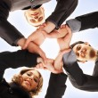 Group handshake with a lot of different hands over blue background — Stock Photo #14984113
