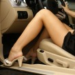 Sexy legs in a car — Stock Photo