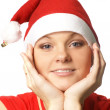 Young attractive adult female playing santa — Stock Photo