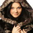 Stock Photo: Attractive young girl wearing fur coat