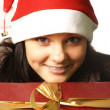 Young attractive adult female with big present — Stock Photo