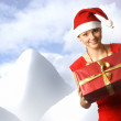 Young attractive adult female with big present — Stock Photo #14989723