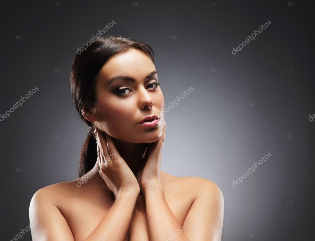 Portrait of young and beautiful woman over grey — Stock Photo #14985625