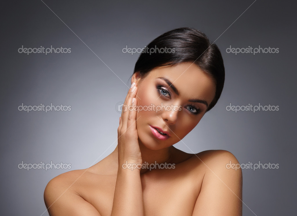 Portrait of young and beautiful woman over grey — Photo #14985847