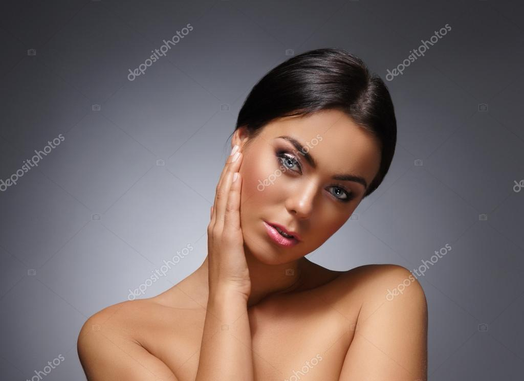 Portrait of young and beautiful woman over grey  Foto Stock #14985847
