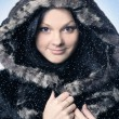 Attractive young girl wearing fur coat — Stockfoto