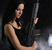 Sexy woman with weapon — Stock Photo