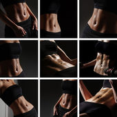Sporty belly over black background — Stock Photo