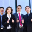 Business team in the street — Stock Photo #15389347