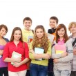 Group of smiling teenagers staying together — Stock Photo #15381403