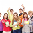 Group of smiling teenagers staying together — Stock Photo