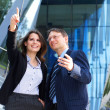 Conceptual photo of businesswoman showing something to her assistant — Stock Photo #15382229
