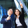 Conceptual photo of businesswoman showing something to her assistant — Stockfoto