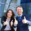 Successful business man and business woman — Stockfoto