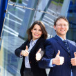 Conceptual photo of businessman and his female assistant — Stock Photo