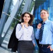 Conceptual photo of businessman and his female assistant — Stock Photo #15382621