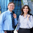 Successful business man and business woman — Stock Photo #15382641