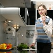 Young, attractive lady in luxury kitchen interior - Photo