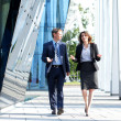 Business walking and talking in the street — Stock Photo