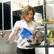 Young, attractive lady in luxury kitchen interior — Foto de Stock