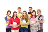 Group of smiling teenagers staying together — Foto Stock