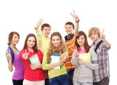 Group of smiling teenagers staying together — Стоковое фото