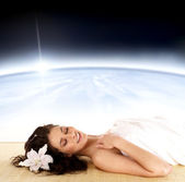 Woman in spa dreaming over abstract space background — Stock Photo